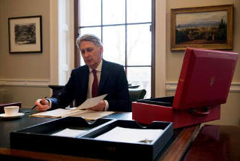 Hammond 'to resist new spending' as public finances pick up